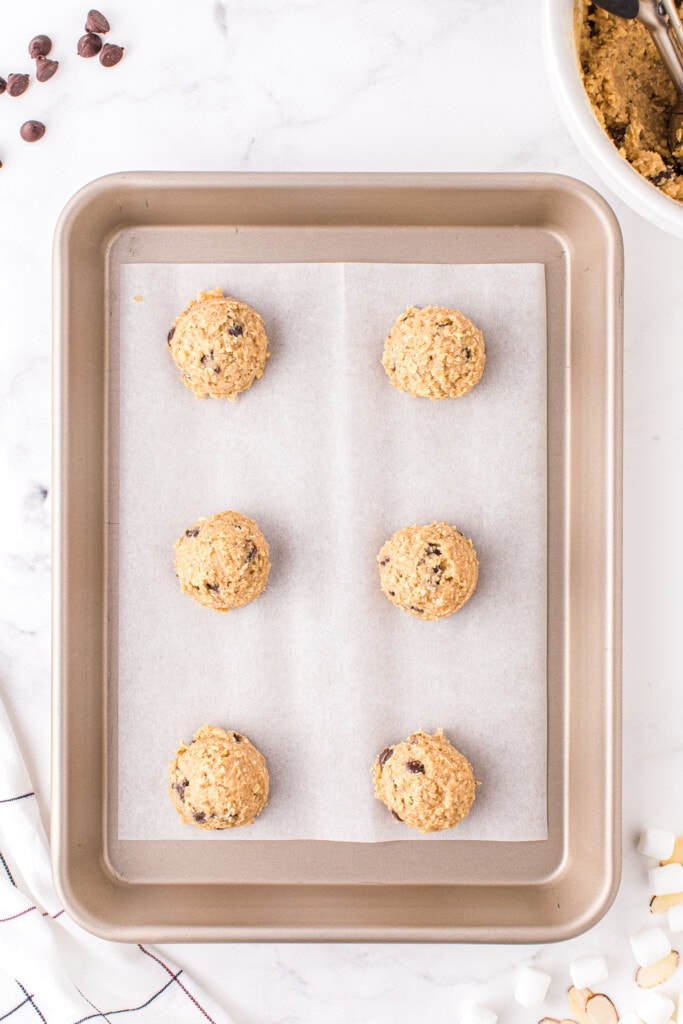 Overhead image of of sheet pan with raw cookie dough on it