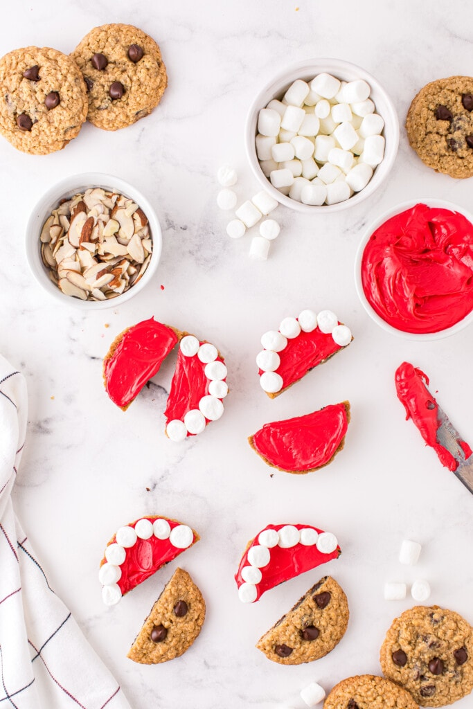 Overhead image of cookies with red frosting and marshmallows